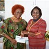 Rosline Cumberbatch receiving her award for Excellent Attendance from Deputy Chairman of TVET Council, Millicent Small