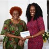 Nicole Collymore receiving her award for Perfect Attendance from Deputy Chairman of TVET Council, Millicent Small
