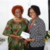 Michelle Haynes receiving her award for Perfect Attendance from Deputy Chairman of TVET Council, Millicent Small